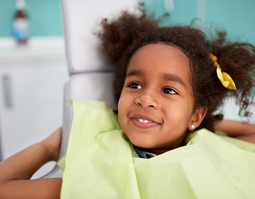 Little girl smiling during dental checkup and teeth cleaning visit