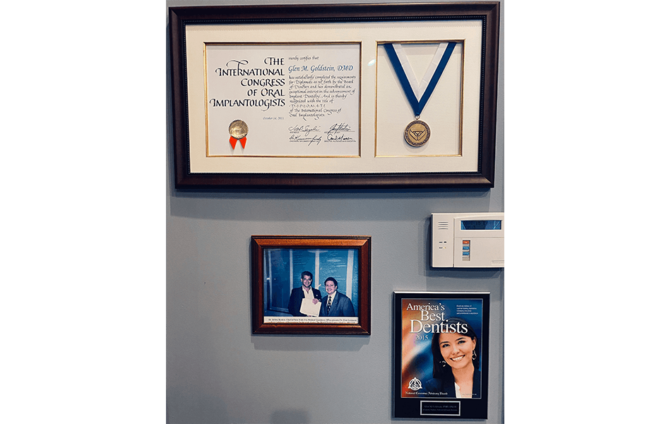 Awards and signs on dental office wall