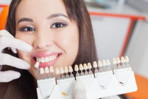 woman posing beside porcelain veneers