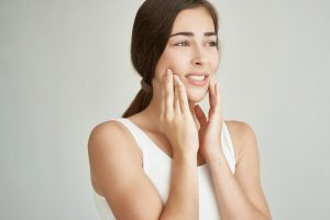 woman with dental pain