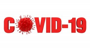 "Text reading ""COVID-19"" with illustration of virus"