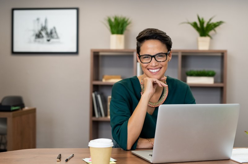 Business woman smiling at her desk